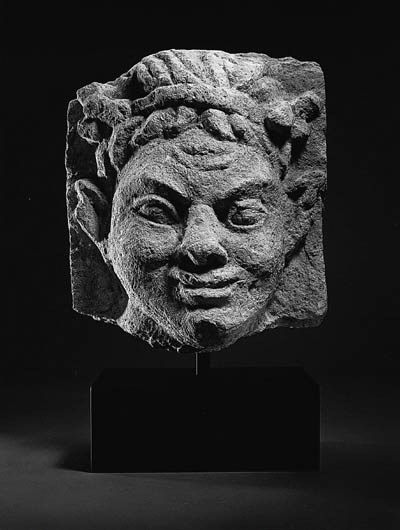 A ROMAN LIMESTONE HEAD OF A SA