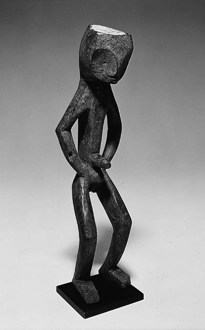 AN MBOLE STANDING MALE FIGURE