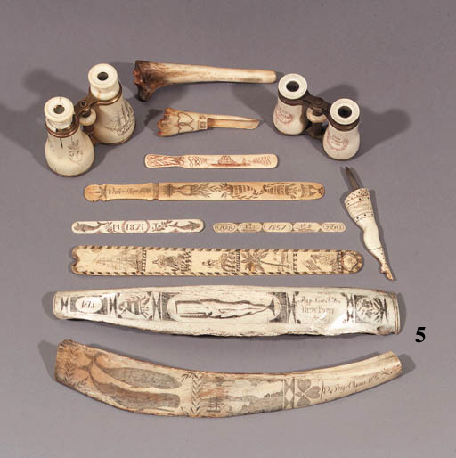 a scrimshaw-decorated whale bone rib