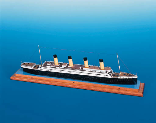 """A WOOD AND METAL WATERLINE MODEL OF THE WHITE STAR LINER RMS """"TITANIC"""""""