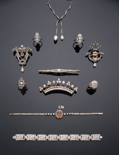 AN ORANGE SAPPHIRE AND DIAMOND