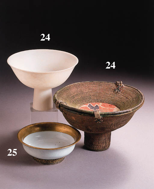 a tibetan fibre container holding a chinese white jade stemcup