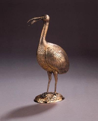 A rare silver-gilt model of a