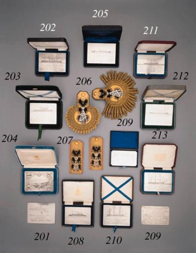 A silver commemorative naval P