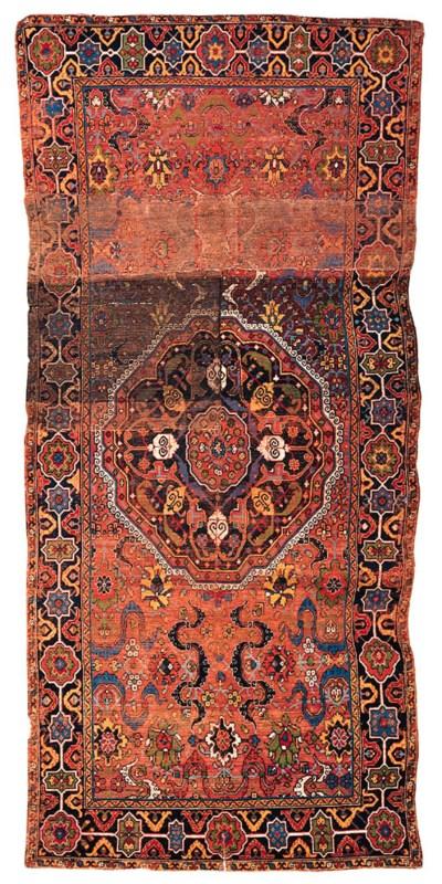 A PERSIAN MEDALLION CARPET