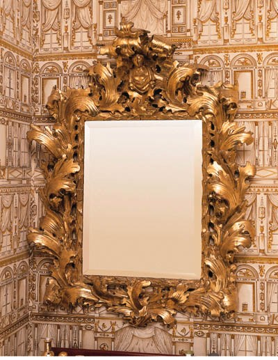 AN ITALIAN GILTWOOD AND COMPOS