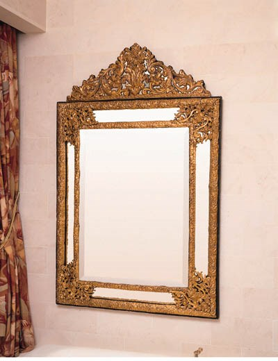 A DUTCH EMBOSSED BRASS AND EBO