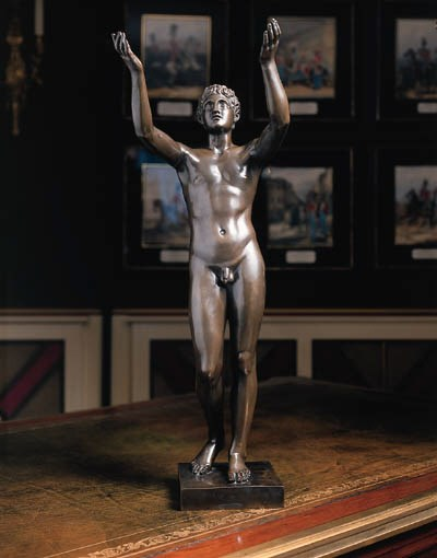 A BRONZE MODEL OF A STANDING Y
