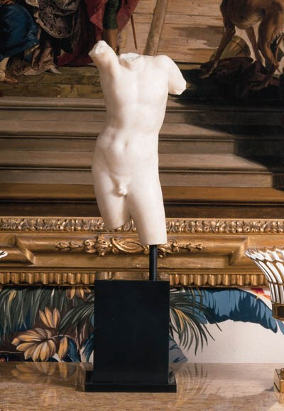 A FRAGMENTARY MARBLE TORSO OF