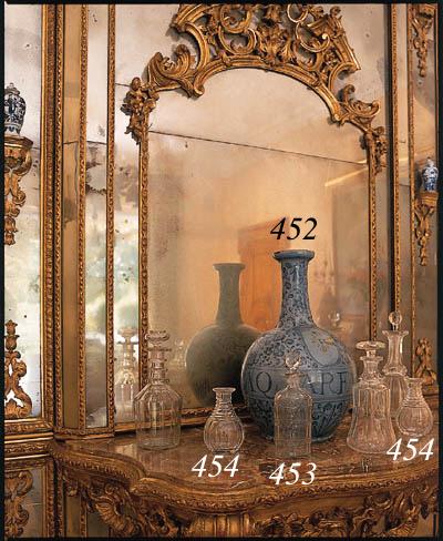 Three fluted cut-glass flasks