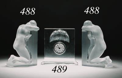 A GLASS MANTEL CLOCK