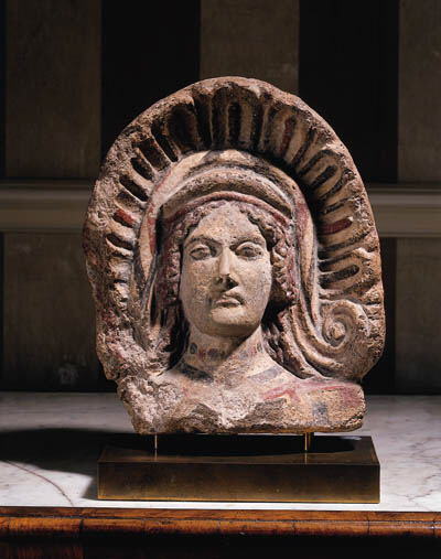 AN ETRUSCAN PAINTED TERRACOTTA