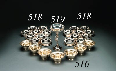 A set of twelve silver-gilt bo