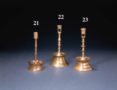 A COPPER ALLOY CANDLESTICK