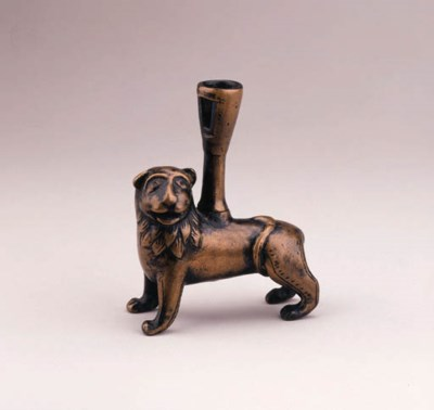 A COPPER ALLOY CANDLESTICK IN