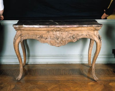 A pair of walnut consoles, pro