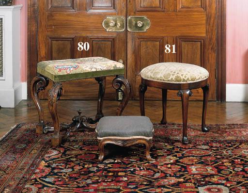 A pair of mahogany oval stools