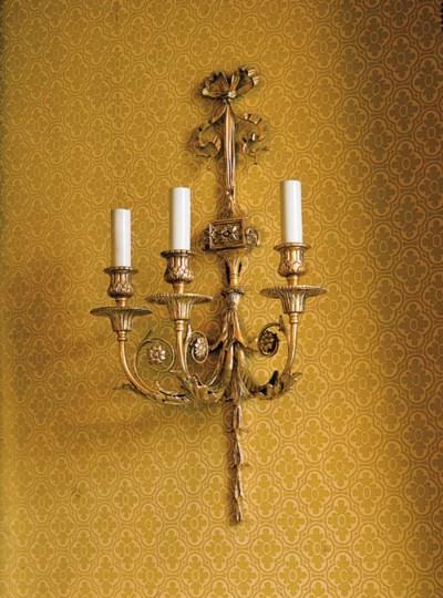 A set of eight Adam style gilt