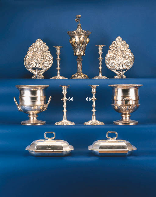 A pair of George II cast candl