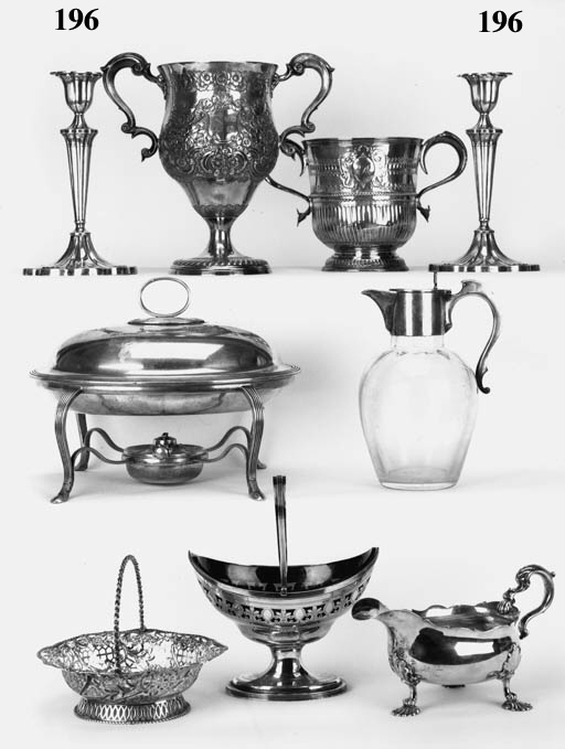 A pair of Edwardian candlesticks with tapering, cluster columns, lobed oval bases and polyfoil nozzles, maker's mark T & S, Sheffield, 1903 - 22.5cm high, loaded. See Illustration  (2)