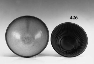A Henan brown glazed pottery b