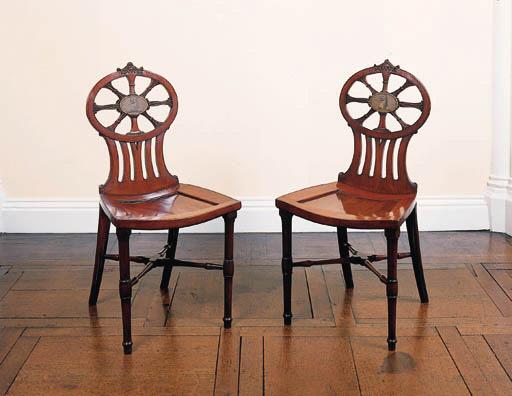A pair of George III mahogany hall chairs