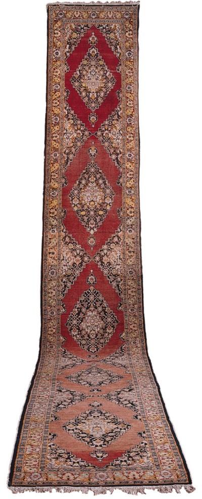 An antique Tabriz runner