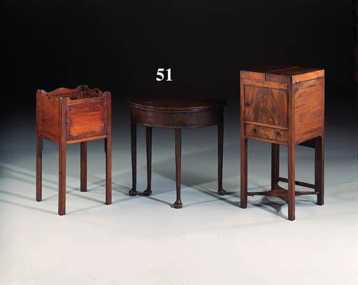 An oak half-round side table