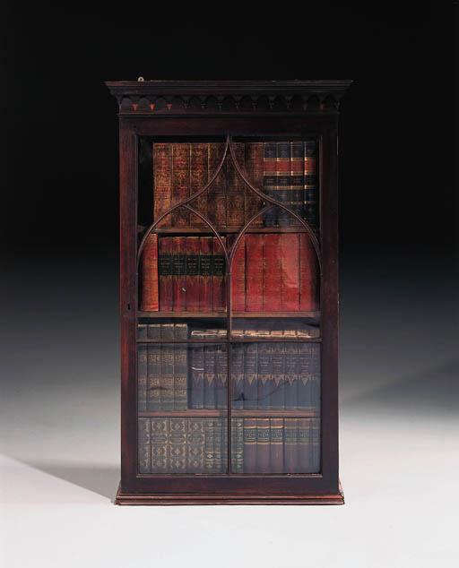 A George III mahogany hanging cupboard