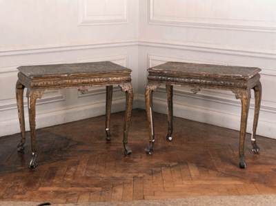 A matched pair of giltwood cen