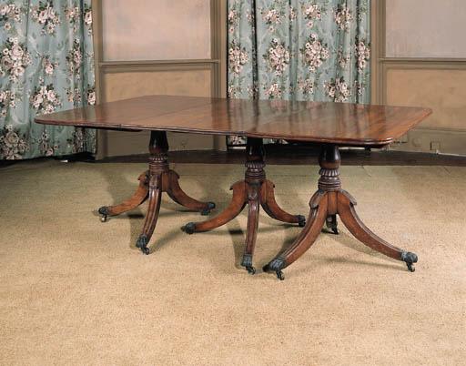A Regency three pedestal dining table