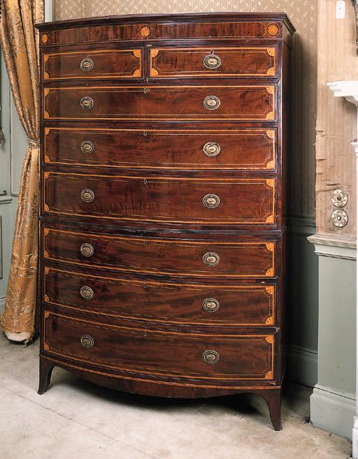 A mahogany and inlaid bowfront tallboy, 19th century