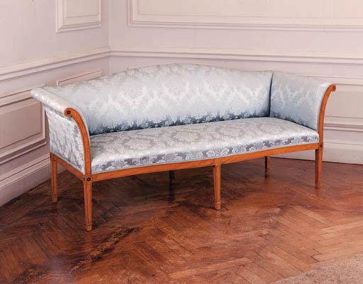 An Edwardian satinwood sofa