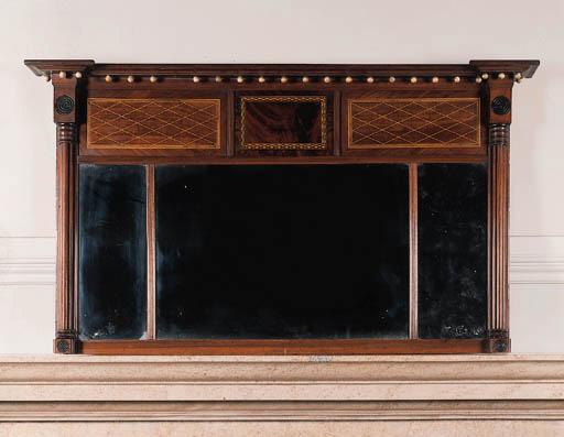 An Edwardian satinwood-strung mahogany overmantel mirror