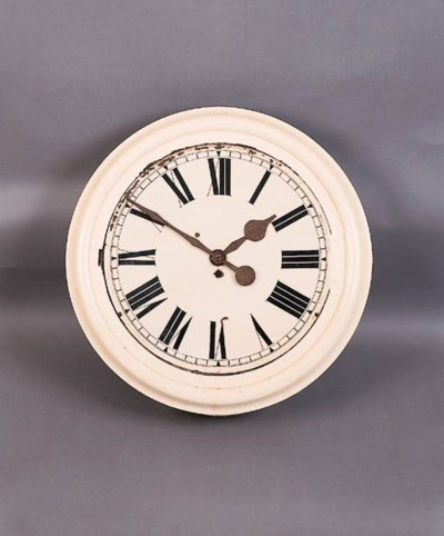 A cream-painted kitchen clock