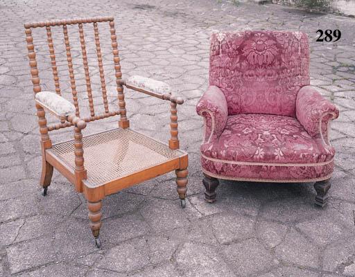 An Edwardian oak easy armchair