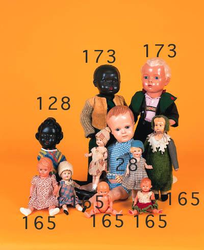 Eight celluloid headed dolls
