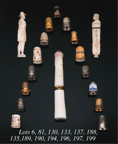 A porcelain thimble,
