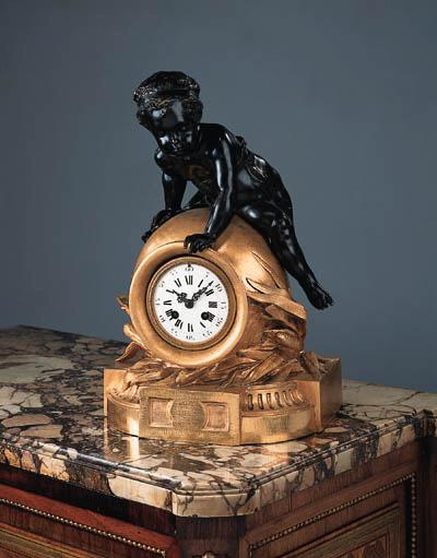 A French bronze mantel clock,