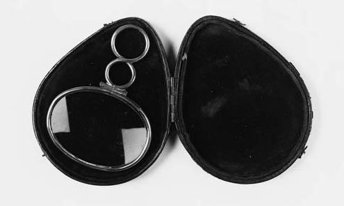 A 19th-Century silver-framed oval-lensed magnifier,