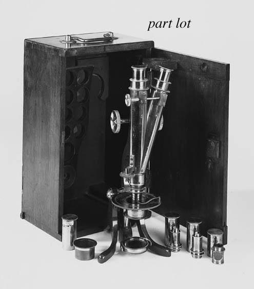A lacquered-brass compound binocular microscope,