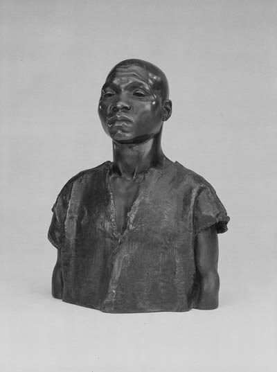A BRONZE BUST OF A NEGRO SLAVE