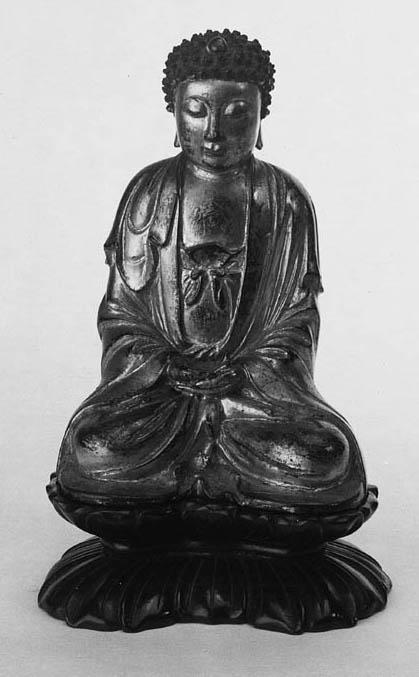 A CHINESE GILT BRONZE SEATED BUDDHA