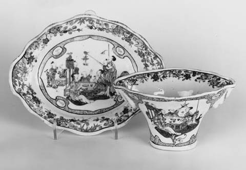 A PAIR OF FAMILLE ROSE LIBATION CUPS AND STANDS