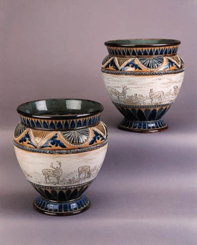 A pair of footed stoneware vas