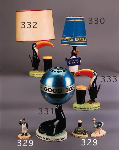 A Guinness Sea-lion lampbase and globe shade