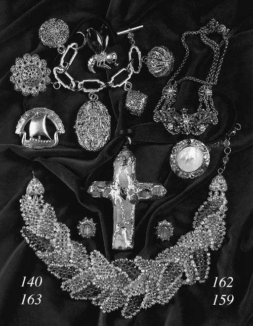A broad bracelet of five large rectangular imitation emeralds, surrounded by clusters of marquise and circular clear pastes, stamped SCHIAPARELLI; a necklace set with imitation pearls and marquise and tear-shaped royal blue pastes, stamped THIEF OF BAGDAD KORDA; a brooch modelled as a Viking longship, stamped CORO; a necklace with circular Art Nouveau pendant set with mother of pearl and small pastes imitating peacock eyes; a brooch modelled as an insect with wings of amber coloured pastes; and a small quantity of costume jewellery(a lot)