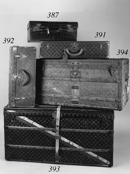 A Louis Vuitton suitcase, covered in LV fabric, bound in brass and reinforced with brass rivets, with two levered clasps, the interior labelled Louis Vuitton Paris London and stamped 42214--24 x 17 x 10.5in. (61 x 43 x 27cm.), few scratches to lid