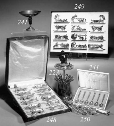 A set of twelve silvered metal