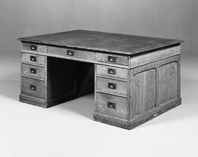 A pine pedestal partners desk
